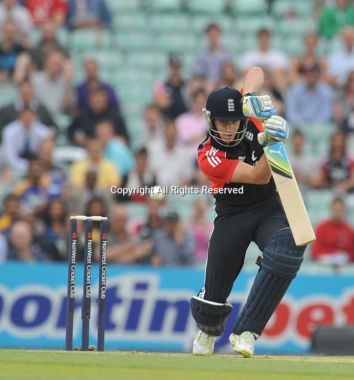 28.06.2011 One Day International Cricket from the Kia Oval in London. England v Sri Lanka. England openner Kieswetter plays a drive off of Malinga.