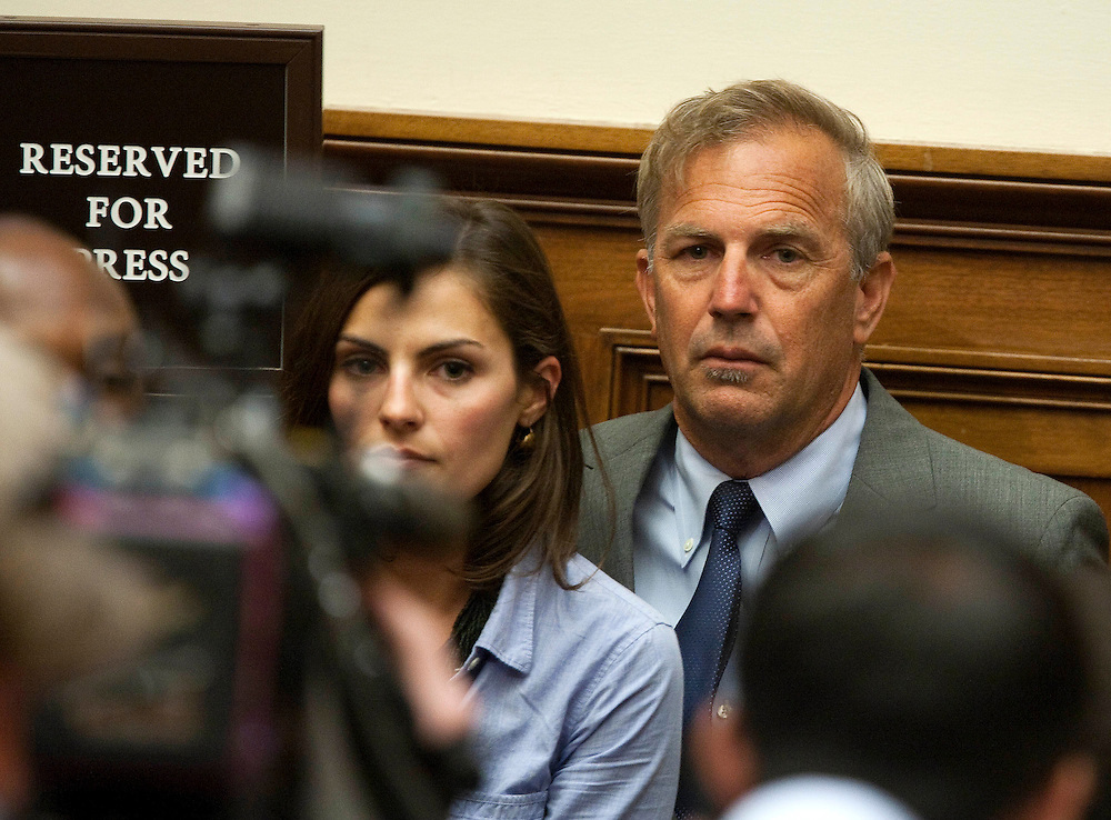 Actor Kevin Costner and his daughter Annie listen to Tony Hayward, chief executive officer of BP Plc, testify to a House Energy and Commerce Committee hearing on the accident in the Gulf of Mexico involving the BP Deepwater Horizon rig in Washington, D.C., U.S., on Thursday, June 17, 2010.  Photographer: Joshua Roberts/Bloomberg *** Local Caption *** Tony Hayward