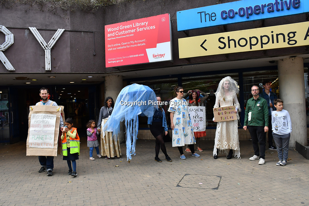 Extinction Rebellion a recycling fashion show ahead of LFW 2019 with all hand made recycling material and old clothing outside Wood Green library to boycott #LFW2019 branded fashion on 7 September 2019, London, UK.