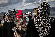 Young migrant womens assisting their kids after crossing the Aegean Sea on the island of Lesvos FEDERICO SCOPPA/CAPTA