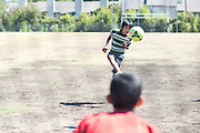 Roshan Biswa (13) takes a shot on goal across the street from his home in the Ivy Apartments where Thomas E. Duncan, the first confirmed Ebola virus patient in the United States, was staying with family in Dallas, Texas on October 4, 2014. Duncan is now being treated at Texas Health Presbyterian Hospital Dallas while members of his family have been isolated in the apartment. (Cooper Neill for The New York Times)