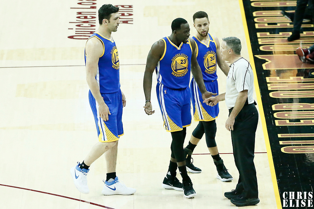07 June 2017: Golden State Warriors center Zaza Pachulia (27), Golden State Warriors forward Draymond Green (23) and Golden State Warriors guard Stephen Curry (30) talk to referee Monty McCutchen (13) during the Golden State Warriors 118-113 victory over the Cleveland Cavaliers, in game 3 of the 2017 NBA Finals, at  the Quicken Loans Arena, Cleveland, Ohio, USA.