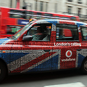 A London Taxi in London City centre as London prepares for the  London 2012 Olympic games, UK. 14th July 2012. Photo Tim Clayton