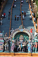 Hindu deities at the entrance to the steps of Batu Caves.