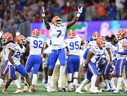 Florida Gators linebacker Jeremiah Moon (7) reacts after the Gators stopped the Michigan Wolverines on a fourth down during the Chick-fil-A Bowl Game at  the Mercedes-Benz Stadium, Saturday, December 29, 2018, in Atlanta. ( AJ Reynolds via Abell Images for Chick-fil-A Kickoff)