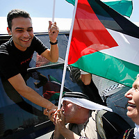 A released Palestinian prisoner hugs relatives after arriving at President Mahmoud Abbas' headquarters in the West Bank city of Ramallah, Friday, July 20, 2007. Israel released more than 250 Palestinian prisoners Friday, in an attempt to bolster moderate Palestinian President Mahmoud Abbas in his power struggle with Hamas. Photo by Michal Fattal/Flash90.