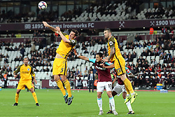 20 October 2017 - Premier League Football - West Ham United v Brighton and Hove Albion - Lewis Dunk of Brighton wins a header over Javier (Chicharito) Hernandez of West Ham and Shane Duffy of Brighton - Photo: Charlotte Wilson / Offside