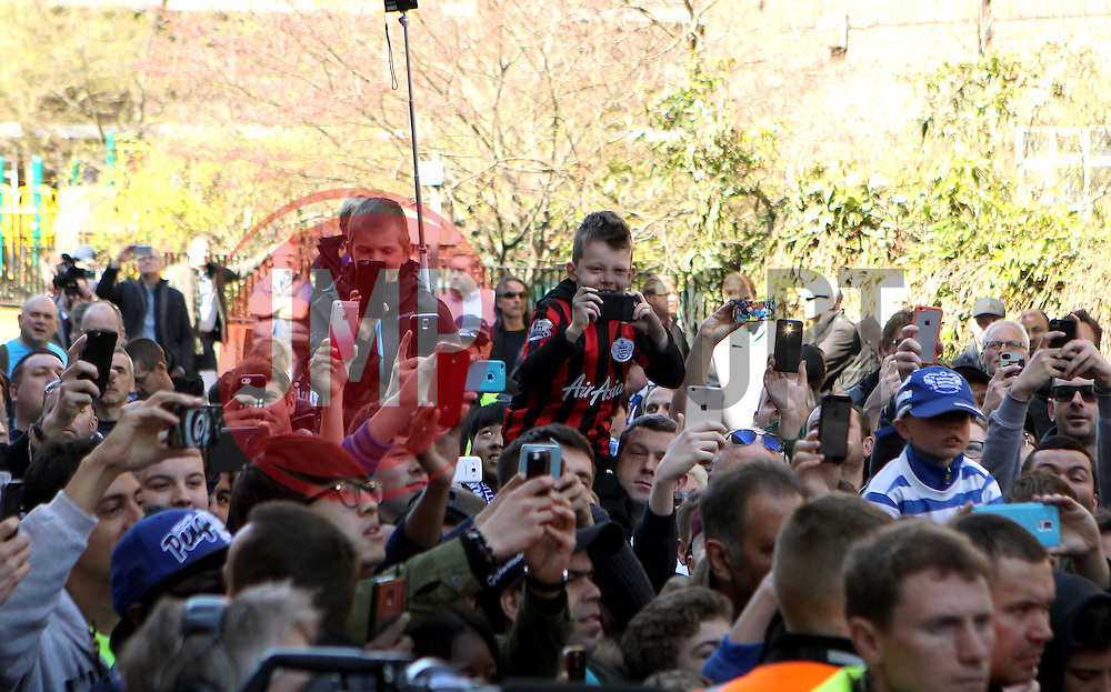 Fans take pictures of the Chelsea players arriving at Loftus Road - Photo mandatory by-line: Robbie Stephenson/JMP - Mobile: 07966 386802 - 12/04/2015 - SPORT - Football - London - Loftus Road - Queens Park Rangers v Chelsea - Barclays Premier League