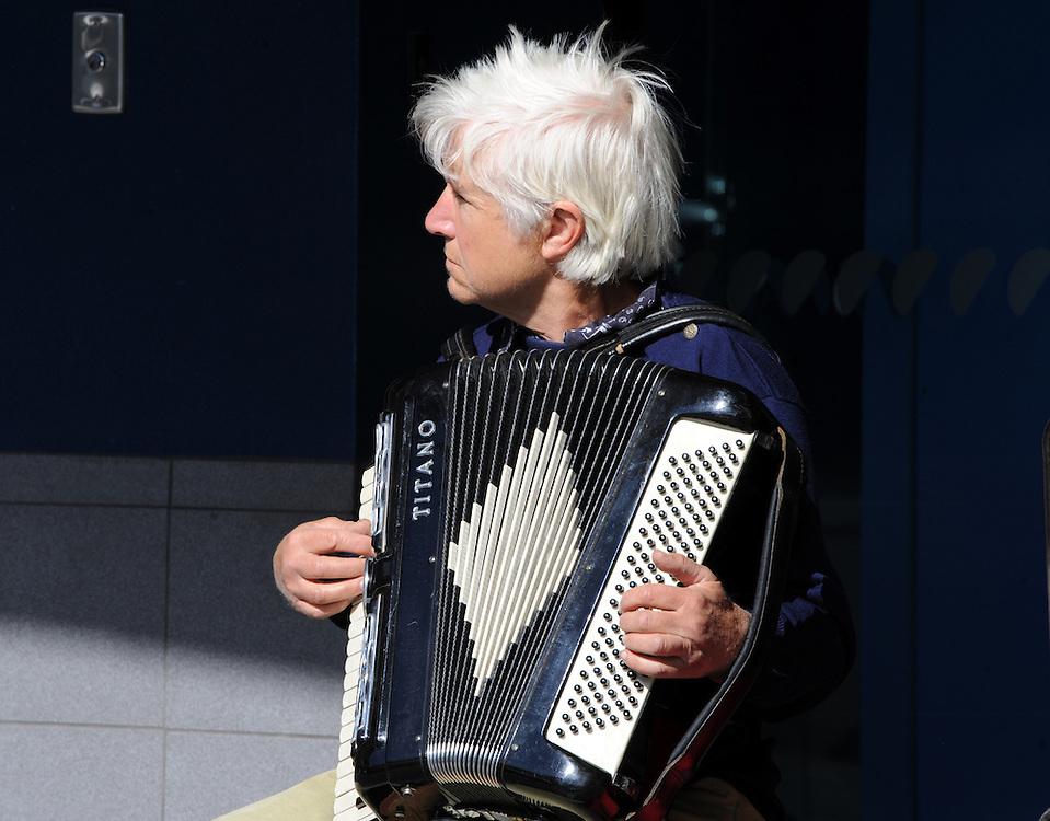 Busker, piano accordion, Nelson, New Zealand, Saturday, November 07, 2015. Credit:SNPA / Ross Setford