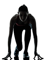 one caucasian woman sprinter on starting block in silhouette studio isolated on white background