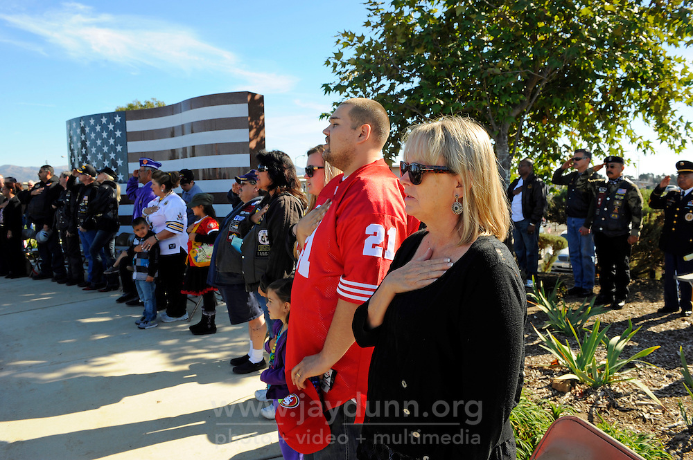 Veterans, their families, friends and supporters pledge allegiance to the flag on Sunday at the Monterey County Vietnam Veterans Memorial in Salinas.