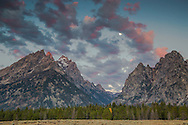 Sunrise moon over Cascade Canyon of the Grand Tetons in Grand Teton National Park.<br />