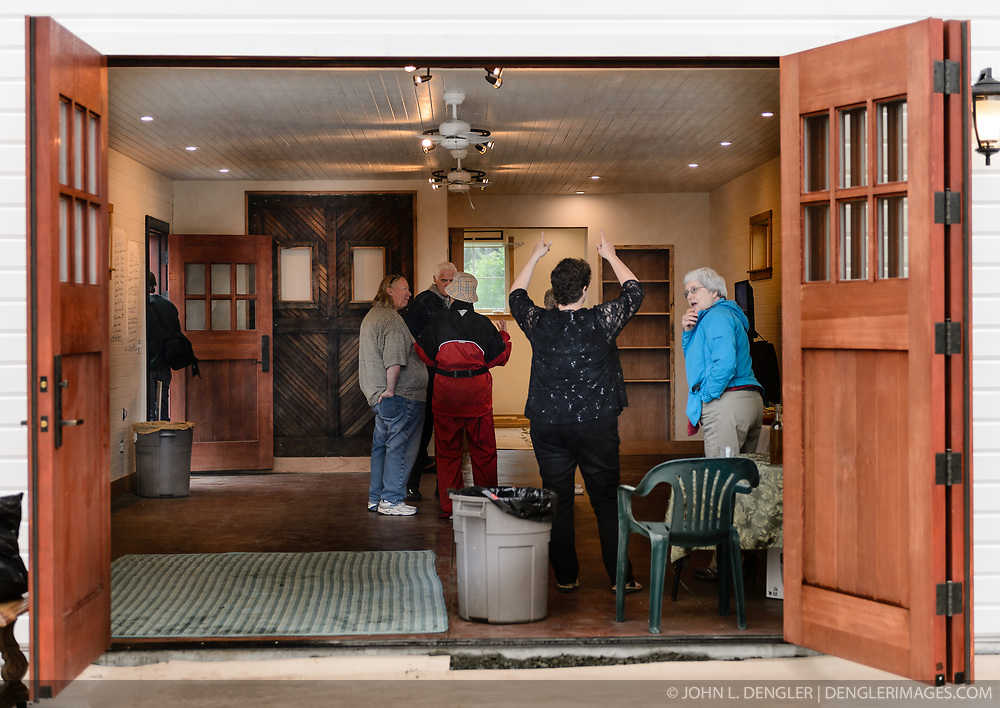 Visitors tour the recently restored fire hall located on the grounds of historic Fort William H. Seward in Haines, Alaska during an open house celebrating the completion of the the fire hall restoration.<br /> <br /> After being absent from the historic Fort Seward skyline since approximately the 1930s, the 60-foot tower of the fort&rsquo;s fire hall has been restored to its original height. The building and tower, built around 1904 in Haines, Alaska, was shortened to approximately half its height in the 1930s for unknown reasons. The restoration included rebuilding a missing 35-foot section of the 60-foot tower whose purpose was to dry fire hoses. The tower restoration was completed by building its four sections on the ground and then hoisting those sections with a crane into place on top of each other.<br /> <br /> Through the years, the historic Fort Seward area, a former U.S. Army post, has been referred to as Fort William H. Seward, Chilkoot Barracks, and Port Chilkoot. The National Historic Landmarks listing record for the fort says that &quot;Fort Seward was the last of 11 military posts established in Alaska during the territory's gold rushes between 1897 and 1904. Founded for the purpose of preserving law and order among the gold seekers, the fort also provided a U.S. military presence in Alaska during boundary disputes with Canada. The only active military post in Alaska between 1925 and 1940, the fort was closed at the end of World War II.&rdquo; <br /> <br /> The bottom portion of the fire hall is being leased as commercial space. Due to fire code restrictions there is no public access to the upper portion of the tower. <br /> <br /> The fire hall was restored over a two-year period by owners Joanne Waterman and Phyllis Sage who also own the fort&rsquo;s original guardhouse located next door to the fire hall. That building, now known as the Alaska Guardhouse, is a bed and breakfast.