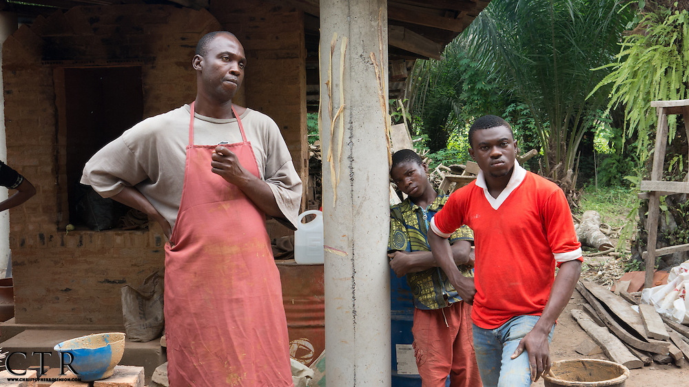 Ibukunoluwa Ayoola with his apprentices at the Atamora Pottery in Atamora, nigeria