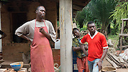 Ibukunoluwa Ayoola with his apprentices at the Atamora Pottery in Atamora, nigeria