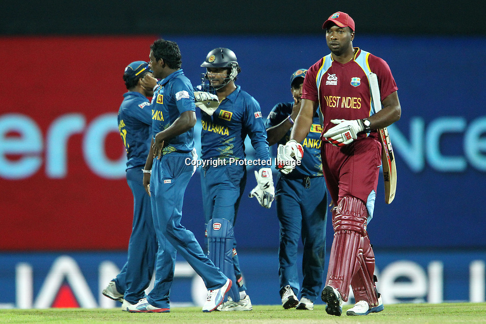 Kieron Pollard of The West Indies departs as Sri Lanka celebrate his wicket during the ICC World Twenty20 Super 8s match between Sri Lanka and The West Indies held at the  Pallekele Stadium in Kandy, Sri Lanka on the 29th September 2012<br /> <br /> Photo by Ron Gaunt/SPORTZPICS