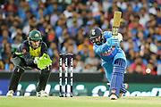 Dinesh Karthik hits down the ground. T20 international, Australia v India. Sydney Cricket Ground, NSW, Australia, 25 November 2018. Copyright Image: David Neilson / www.photosport.nz