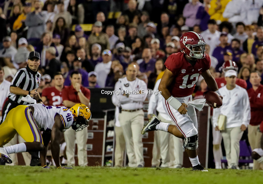 Nov 3, 2018; Baton Rouge, LA, USA; Alabama Crimson Tide quarterback Tua Tagovailoa (13) runs for a touchdown against the LSU Tigers during the third quarter at Tiger Stadium. Mandatory Credit: Derick E. Hingle-USA TODAY Sports