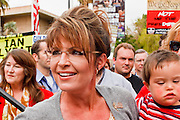22 OCTOBER 2010 - PHOENIX, AZ:  SARAH PALIN and her son TRIG at a Tea Party rally in Phoenix, AZ, Friday. About 300 people attended a Tea Party rally on the lawn of the Arizona State Capitol in Phoenix Friday. They demanded lower taxes, less government spending, repeal of the health care reform bill, and strengthening of the US side of the US - Mexican border. They listened to Arizona politicians and applauded wildly when former Alaska Governor Sarah Palin and her son, Trig, made a surprise appearance. The event was a part of the Tea Party Express bus tour that is crossing the United States.     Photo by Jack Kurtz