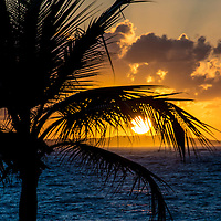The Caribbean is a region of the world comprised of island countries, Central American countries and northern South American countries mostly sitting on the Caribbean tectonic plate.  This Caribbean sunset was taken on the shore of Grace Bay Beach on the island of Providenciales in the country of the Turks and Caicos Islands.
