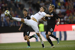 July 24, 2018 - Cluj-Napoca, Romania - CFR Cluj's George Tucudean (C) in action against Malmö FF's Behrang Safari (L) and Rassmus Bengtsson during CFR 1907 Cluj v Malmö FF UEFA Champions League, Second Qualifying Round, Stadium Dr. Constantin Radulescu, Cluj-Napoca, Romania, 24 July 2018. (Credit Image: © Alex Nicodim/NurPhoto via ZUMA Press)
