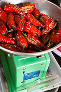 stuffed red chilies at a stall in ho chi minh city's cholon / chinatown market, vietnam