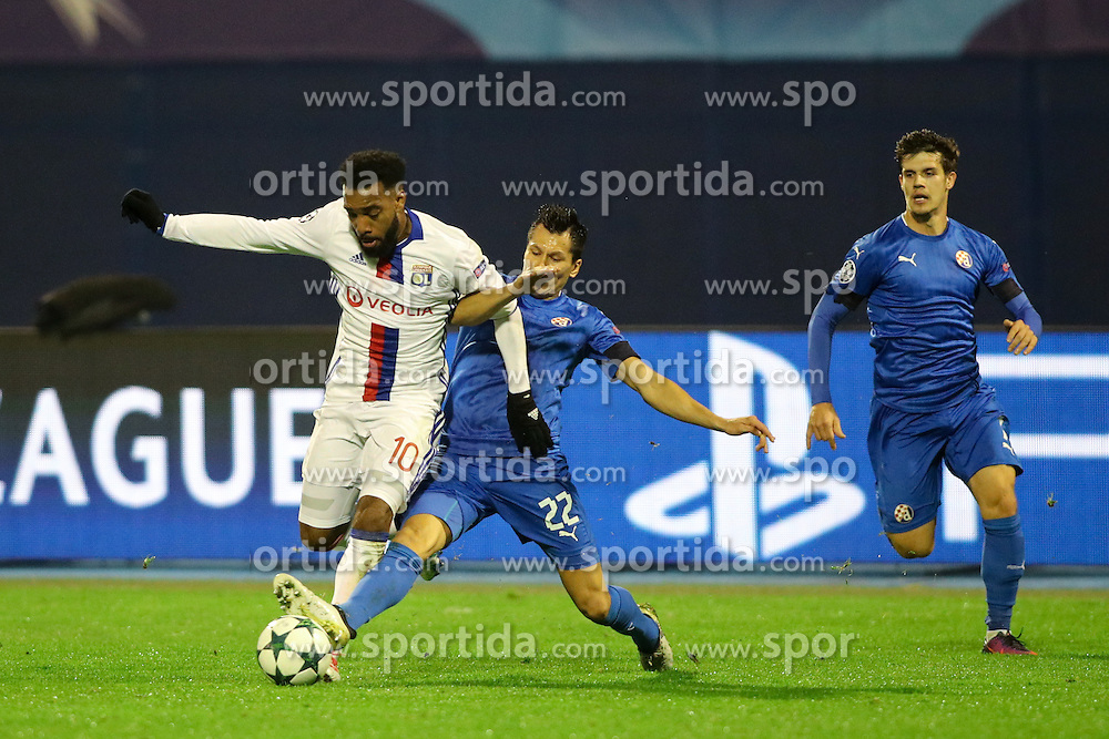 Leonardo Sigali of GNK Dinamo Zagreb vs Alexandre Lacazette of Lyon during football match between GNK Dinamo Zagreb and Olympique Lyonnais in Group H of Group Stage of UEFA Champions League 2016/17, on November 22, 2016 in Stadium Maksimir, Zagreb, Croatia. Photo by Morgan Kristan / Sportida