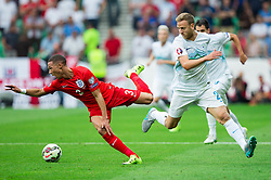 Kieran Gibbs of England and Ales Mertelj of Slovenia during the EURO 2016 Qualifier Group E match between Slovenia and England at SRC Stozice on June 14, 2015 in Ljubljana, Slovenia. Photo by Vid Ponikvar / Sportida