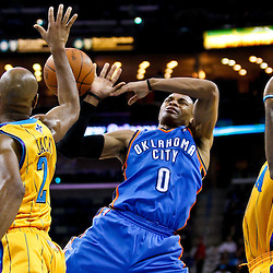 December 10, 2010; New Orleans, LA, USA; New Orleans Hornets small forward Quincy Pondexter (20) strips the ball from Oklahoma City Thunder guard Russell Westbrook (0) and point guard Jarrett Jack (2) defends the play during the first half at the New Orleans Arena.  Mandatory Credit: Derick E. Hingle-US PRESSWIRE