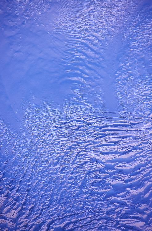 Crevasses catch sunset light on Albert Glacier, west of Mt Tasman in Mt Cook National Park