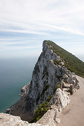 View south along the spine of the Rock of Gibraltar, within the nature reserve looking towards Africa. Photographs from the top of the Rock of Gibraltar. Images of Gibraltar, the British overseas territory located on the southern end of the Iberian Peninsula at the entrance of the Mediterranean.