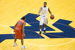 West Virginia Mountaineers guard Juwan Staten (3) calls out a play against the Texas Tech Red Raiders during the second half at the WVU Coliseum.