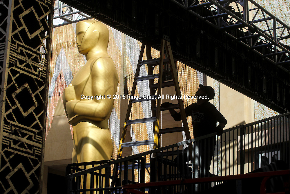 A worker sets up for the Oscars in front of the Dolby Theatre in Los Angeles, Wednesday, February 24, 2016. The 88th Academy Awards will be held Sunday, February 28, 2016. (Photo by Ringo Chiu/PHOTOFORMULA.com)<br /> <br /> Usage Notes: This content is intended for editorial use only. For other uses, additional clearances may be required.