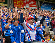 Wakefield Trinity Wildcats fans celebrate an early try during the Ladbrokes Challenge Cup Semi-Final  match Warrington Wolves -V- Wakefield Trinity Wildcats at , Leigh, Greater Manchester, England on Saturday, July 30, 2016. (Steve Flynn/Image of Sport)