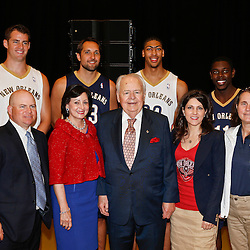 Aug 1, 2013; Metairie, LA, USA; New Orleans Pelicans owner Tom Benson poses with his family and players (left to right) Jason Smith, Ryan Anderson, Anthony Davis and Jrue Holiday during a uniform unveiling at the team practice facility. Mandatory Credit: Derick E. Hingle-USA TODAY Sports