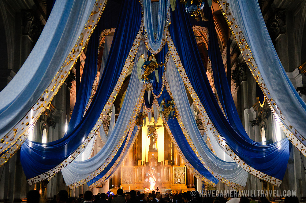 A religious ceremony takes place at night inside the Iglesia San Francisco (St. Francis Church) in downtown Guatemala City.