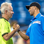 August 25, 2016, New Haven, Connecticut: <br /> John McEnroe and James Blake shake hands during the Men's Legends Event on Day 7 of the 2016 Connecticut Open at the Yale University Tennis Center on Thursday, August  25, 2016 in New Haven, Connecticut. <br /> (Photo by Billie Weiss/Connecticut Open)