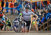 SHOT 1/12/14 4:33:16 PM - Walton Brush (#101) of Portland, Ore. shoulders his bike in the 5280' Run Up section in the Men's Elite Race at the 2014 USA Cycling Cyclo-Cross National Championships at Valmont Bike Park in Boulder, Co. (Photo by Marc Piscotty / © 2014)
