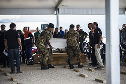 August 30, 2016 - Amatrice, Italy - A coffin during a funeral mass for victims of earthquake on August 30, 2016 in Amatrice, Italy. Italy has declared a state of emergency in the regions worst hit by Wednesday's earthquake as hopes diminish of finding more survivors. At least 290 people are now know to have died and around 400 injured with teams continuing to search the rubble of collapsed buildings. (Credit Image: © Manuel Romano/NurPhoto via ZUMA Press)
