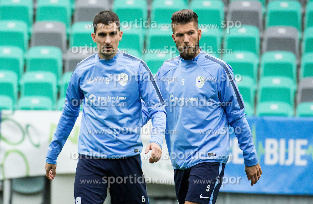 Branko Ilic and Bostjan Cesar during practice session of Slovenian National Football team two days before Euro 2016 Qualifying game between Slovenia and Lithuania, on October 7, 2015 in SRC Stozice, Ljubljana Slovenia. Photo by Vid Ponikvar / Sportida