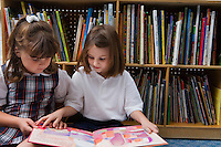 Little Girls Looking at a Picture Book