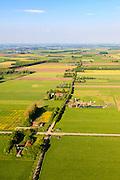 Nederland,  Land van Maas en Waal, Gelderland, 27-05-2013; West Maas en Waal, oorspronkelijk een gebied van komgronden (laag gelegen en nat gebied), versnipperd en slecht ontsloten. Foto langs een van Nederlands bekendste boerderijstraten Kooiweg-Papesteeg-Liesbroekstraat-Hoogbroekstraat.<br /> Grootschalige ruilverkaveling in combinatie met cultuurtechnische gebiedsverbetering is in de jaren vijftig (jaren '50) van de vorige eeuws gecombineerd met voorlichting en scholing van de bewoners.<br /> The low and wet land between the rivers Maas and Waal, central Netherlands  has been developed in the fifties by large-scale land consolidation and education, development and training of the residents. One of the main roads along the farms.<br /> luchtfoto (toeslag op standard tarieven)<br /> aerial photo (additional fee required)<br /> copyright foto/photo Siebe Swart