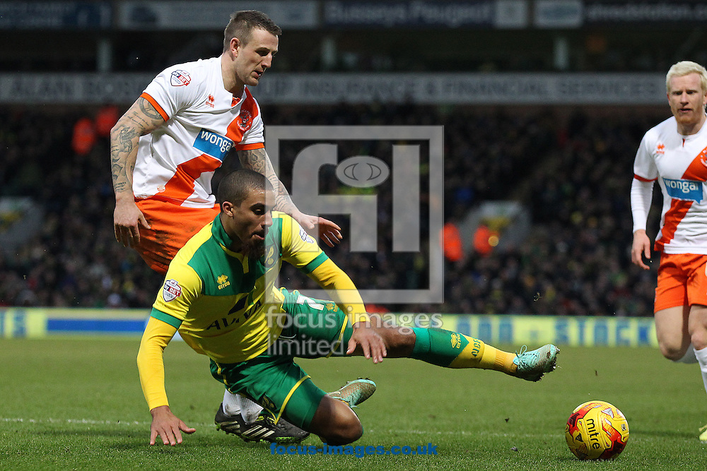 Lewis Grabban of Norwich is fouled by Peter Clarke of Blackpool and a penalty is awarded by Referee Simon Hooper during the Sky Bet Championship match at Carrow Road, Norwich<br /> Picture by Paul Chesterton/Focus Images Ltd +44 7904 640267<br /> 07/02/2015