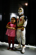 Lucha Libre AAA wrestler Mascarita Sagrada poses with a fan in Sacramento, CA March 28, 2009.