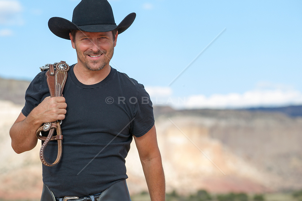 good looking forty something year old cowboy outdoors handsome middle aged cowboy outdoors in The Southwest