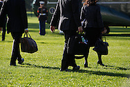 The presidential handlers walk to Marine One as President Barack Obama departs the White House for a campaign stop in New Hampshire and New York On October 18, 2012. photo by Dennis Brack...