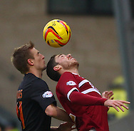 Picture by David Horn/Focus Images Ltd +44 7545 970036<br /> 16/11/2013<br /> Chris Hackett of Northampton Town and Jeff Hughes of Fleetwood Town during the Sky Bet League 2 match at Sixfields Stadium, Northampton.