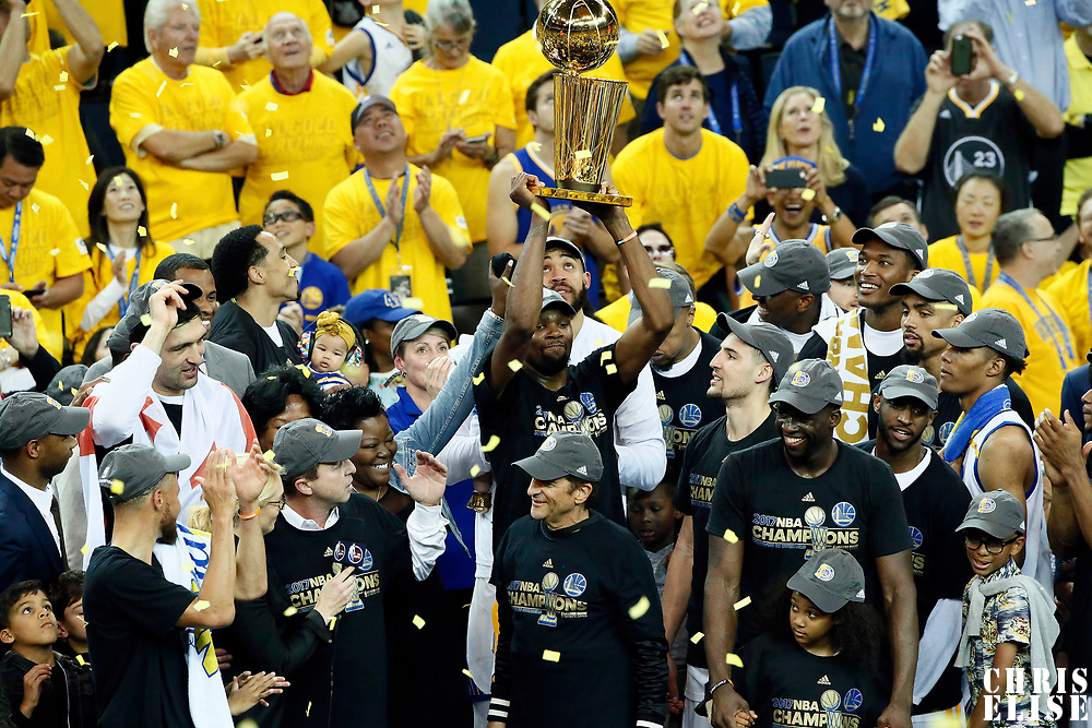 12 June 2017: Celebration with the Larry O'Brien NBA Championship Trophy by Golden State Warriors forward Kevin Durant (35) and the team during the Golden State Warriors 129-120 victory over the Cleveland Cavaliers, in game 5 of the 2017 NBA Finals, at the Oracle Arena, Oakland, California, USA.