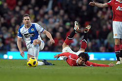 Rafael da Sliva (Man Utd) is sent flying by David Dunn (Blackburn) during the Barclays Premier League match between Manchester United and Blackburn Rovers at Old Trafford on November 27, 2010 in Manchester, England.