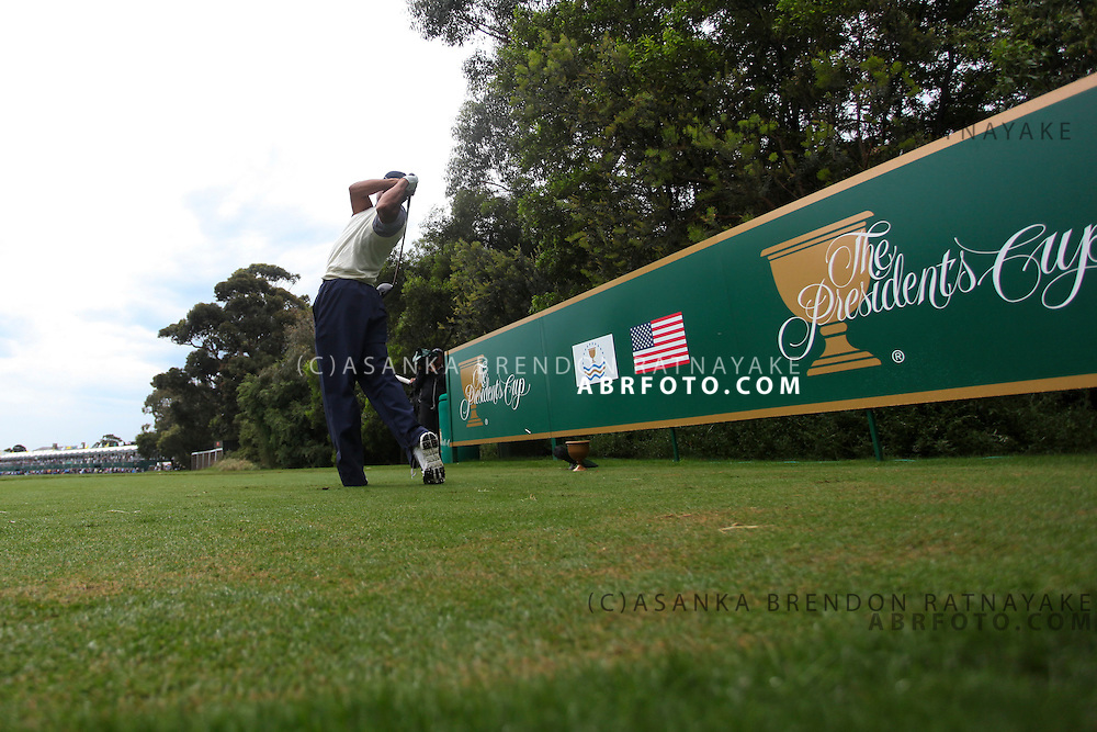 19 November 2011 : Tiger Woods tees off towards the gallery at the 17th hole during the third-round Foursome matches at the Presidents Cup at the Royal Melbourne Golf Club in Melbourne, Australia. .